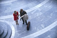 High angle view of businessman and businesswoman standing together