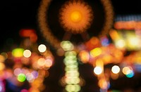 Defocused view of fairground lit up at night, Oktoberfest, Munich, Bavaria, Germany