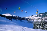 Hot air balloons above snowcoverd landscape, Alps, Tyrol, Austria