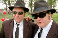 Twin brothers looking and dressing like Jake and Elwood Blues of the Blues Brothers movie