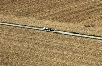 Aerial shot of farmer harvesting crops