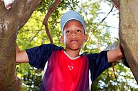 Young teenager climbing a tree