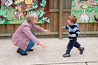 Young boy running towards his grandmother,
