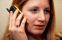 Teenage girl talking on mobile phone,