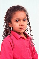 Portrait of young girl with hair in ringlets,