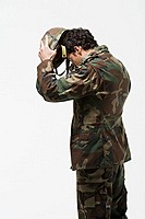 Soldier putting on helmet (thumbnail)