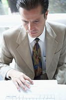 High angle view of a businessman looking at a diary