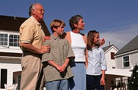 Grandchildren and grandparents standing in front of house, (10-11), (12-13)