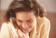 Businesswoman using telephone, close-up