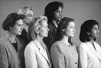 Group of businesswomen standing together, looking away (B&W)