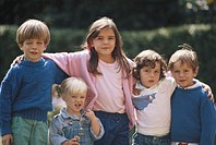 Children (3-9) standing outdoors, arm in arm