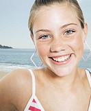 Teenage girl (13-15) on beach, portrait, close-up (digital composite)
