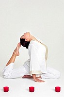 Woman practicing yoga (thumbnail)