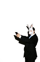 Businessman in rabbit mask aiming a pistol