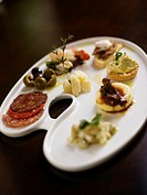 Antipasto platter including olives, cheese and crostini, elevated view