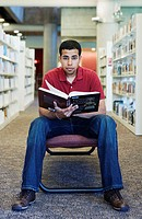 Man holding book in library