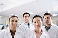 Close up group portrait of technicians in lab (thumbnail)