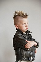 Portrait of boy with mohawk in leather jacket