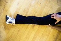 Leg of person stretching