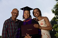 Female graduate with parents