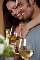 Close up of couple hugging and drinking wine
