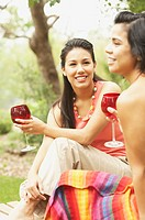 Two young women holding glasses of wine