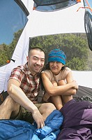 Couple posing inside their tent