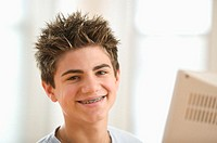 Close up portrait of teenage boy smiling with braces