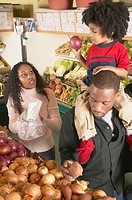 African American couple with young son in supermarket
