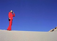 Businesswoman Using Cell Phone in the Desert