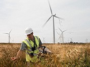 Male wind power plant worker at wind farm
