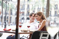 Spain, Barcelona, Placa Real, couple at table in outdoor cafe