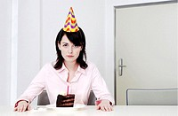 Businesswoman celebrating birthday alone