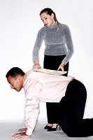 Woman placing documents on her colleague's back