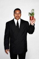 Businessman holding a pot of plants.