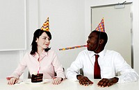 Businesswoman celebrating her birthday with a colleague