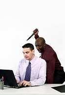 Businessman trying to stab his colleague with a knife
