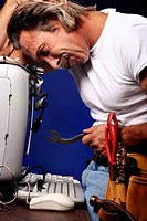 Man trying to fix his computer.
