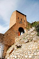 North African man. Tower and gate. Chefchaouen. Morocco