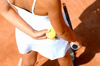 Top View of Female Tennis Player Holding Ball