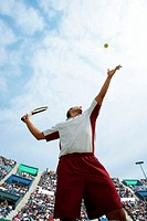 Male Tennis Player Serving