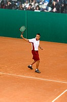 Male Tennis Player Hitting Backhand