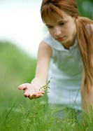 Girl looking at plant