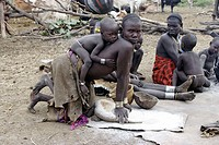 Mursi woman and child. Omo valley tribe. South Ethiopia.