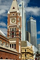 Clock tower of the Perth Town Hall juxtaposed against modern buildings. Australia. December 2005