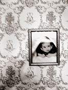 A photo of an infant child portriat is captured with a blurred effect.