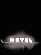 The glowing neon sign for an inexpensive motel is captured in Black and White at night