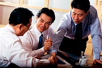 Three businessmen talking in an office