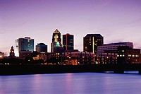Buildings on the waterfront lit up at dusk, Des Moines River, Des Moines, Iowa, USA