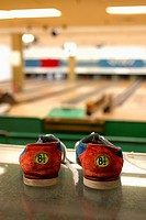 Pair of bowling shoes in a bowling alley